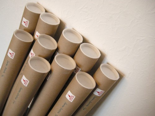 The first batch of prints, rolled up, labelled and ready to go.