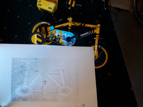 A donor bike and the measurements of the drawing it is to become